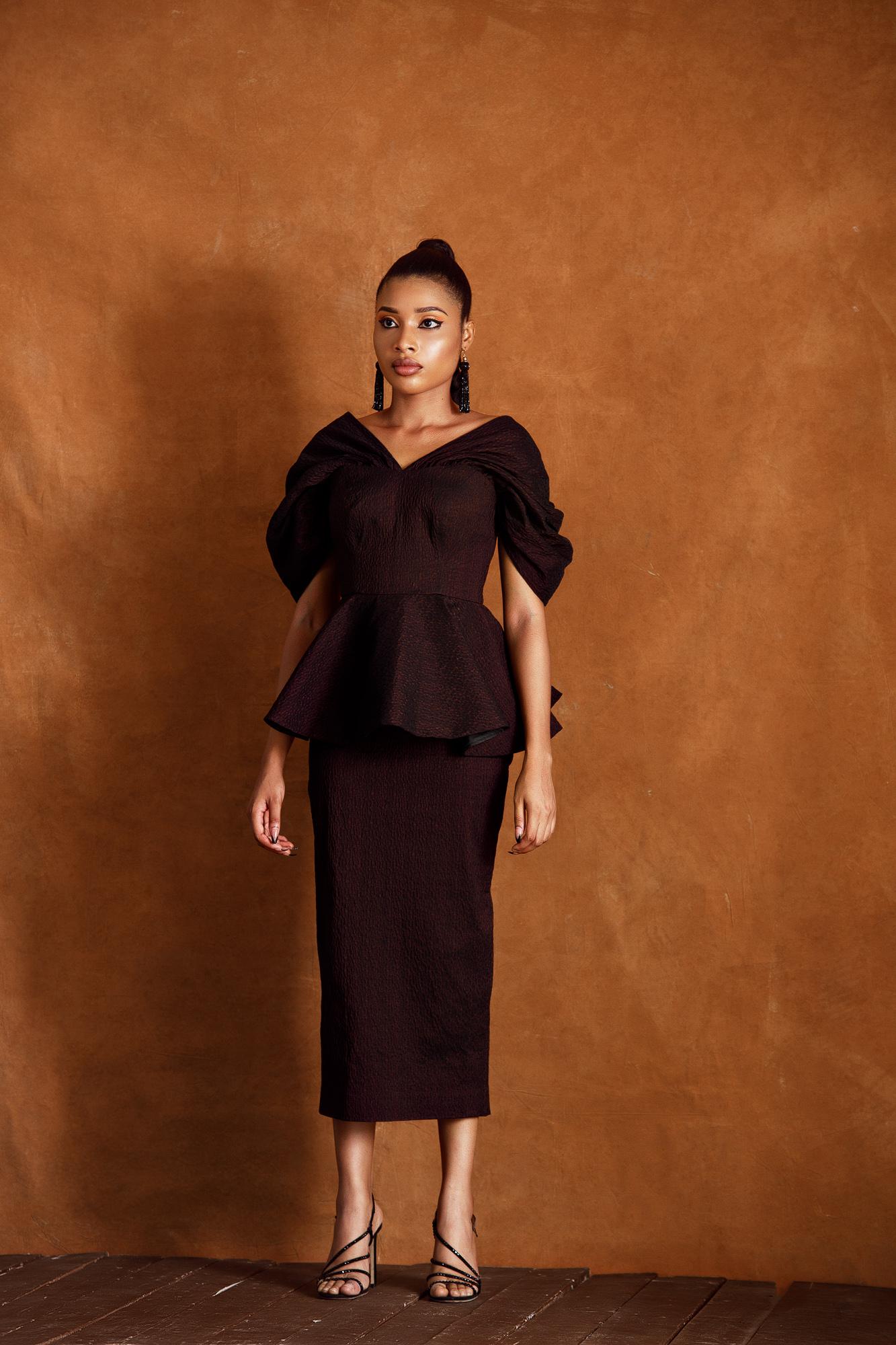 Modupe Peplum Midi Dress